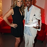 Mariah Carey and Nick Cannon posed together with sneakers at the Project Canvas Exhibition & Art Gala in NYC.