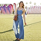 The perfect denim jumpsuit got topped off with neutral wedges, a skinny belt, and a midsize crossbody bag.