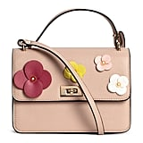 Fun floral embellishments make the H&M Mini Shoulder Bag ($40) perfect for a Spring to Summer transition.