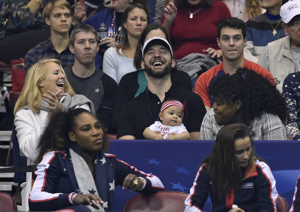 Serena Williams's daughter, Alexis Olympia, may only be 5 months old, but you better believe she and dad Alexis Ohanian were front and center at the Fed Cup in North Carolina on Sunday. The father-daughter duo were on hand to watch Serena and Venus compete in a doubles match against Lesley Kerkhove and Demi Schuurs, but it was little Alexis who stole the show with her cuteness. Not only did she look adorable in her little red-and-white outfit, but the event also marked Alexis's first public appearance and Serena's official return to competitive tennis since becoming a mom. Sadly, Serena didn't win, but with a family like hers, she's always a winner.