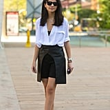 A slouchy blouse tucked into a leather skirt
