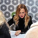 Rachel Zoe made autographs out to fans.