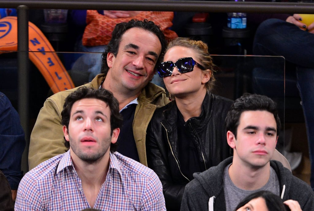Mary-Kate Olsen and Olivier Sarkozy watched basketball.