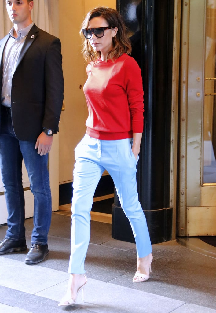 Wearing a Red Sweater With Baby Blue Trousers | Victoria Beckham ...