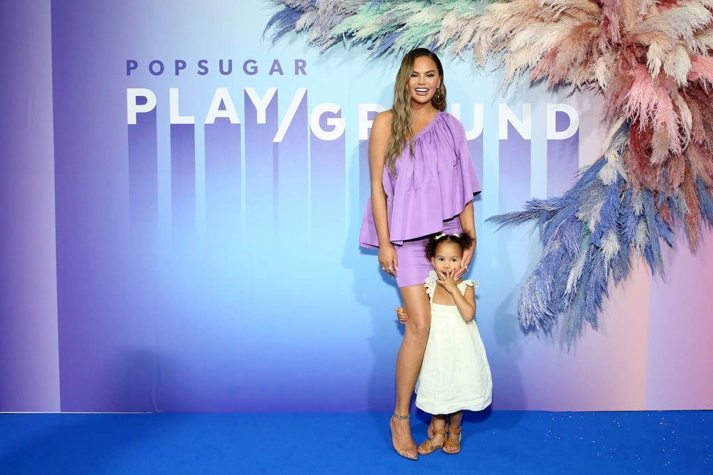 Chrissy Teigen took POPSUGAR Play/Ground by storm on June 23 with the help of her little sidekick Luna. As one of the headliners in NYC, Chrissy was interviewed by her real-life BFF, celebrity hairstylist Jen Atkin. They discussed social media, relationships, and authenticity, and for a brief moment, they were joined by Chrissy's 3-year-old adorable daughter. Not only did Luna make an appearance on stage, but she also walked the blue carpet with Chrissy and played around on the cloud swings. How cute! With parents like Chrissy and John Legend, she's a star in the making. Keep reading to see more snaps from Chrissy and Luna's day at Play/Ground — can we hang out with them all the time?