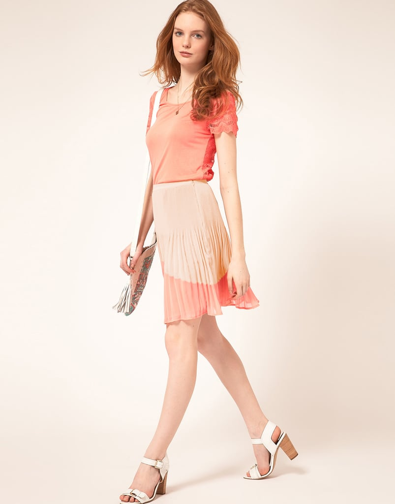 With both pleats and a hint of pretty colorblocking, this skirt makes zeroing in on Spring's major trends effortless.  Oasis Color Block Pleat Skirt ($90)