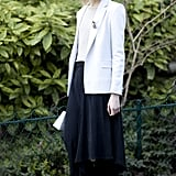 We love the layers here — a calf-length skirt over slim pants, plus a blazer is a perfect transitional look.