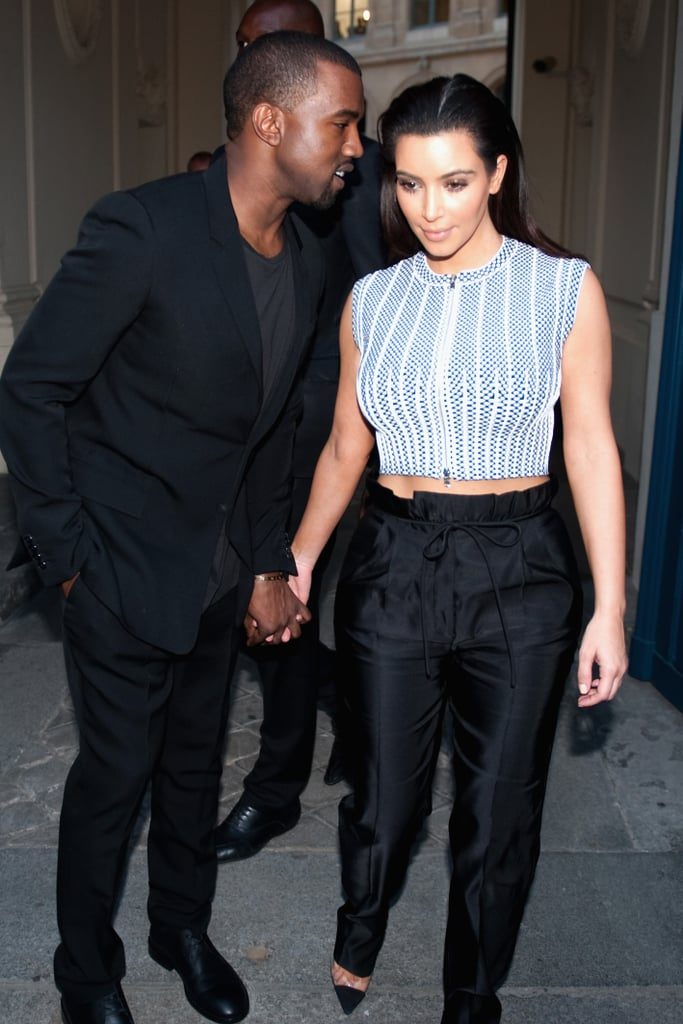 Kanye whispered in Kim's ear while they visited Paris in July 2012.