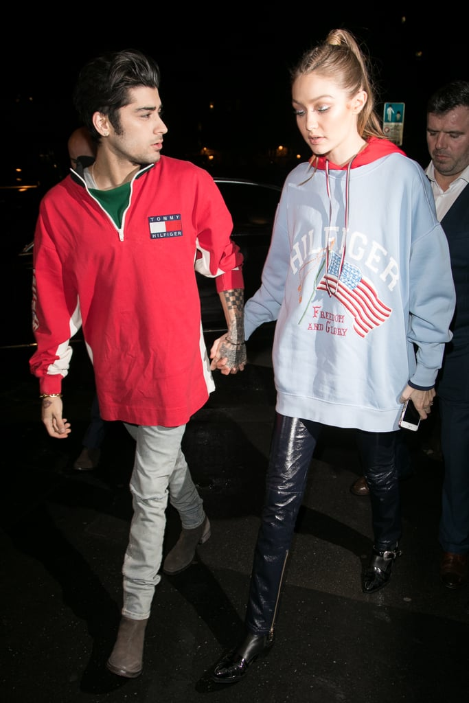 Gigi promoted her collection at Paris Fashion Week with the support of her boyfriend, Zayn, styling her shiny pants with an oversize sweatshirt.