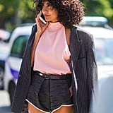 Mismatch your suiting with a pair of tailored shorts, silk blouse, and contrasting blazer for day or night.