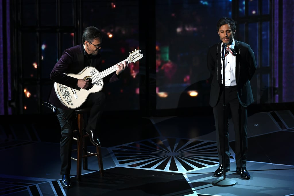"When Coco star Gael García Bernal stepped onstage to perform at the 2018 Oscars, he sent a loud and proud message to his home country of Mexico before even opening his mouth. The actor, who voices Héctor Rivera in the touching Disney-Pixar film about the Mexican holiday Día de los Muertos, wore a special tie for his performance of ""Remember Me."" You might have missed the tie if you were distracted by the beautiful set, or by Miguel and Natalia Lafourcade's impressive duet that followed Bernal's opening song, but it's an important detail: a red, white, and green ribbon bow-tie modeled after the Mexican flag. Coco is the biggest blockbuster in Mexico's history, and Bernal's tie is just one of many nods to the nation throughout Coco's Oscars presence: comedian Eugenio Derbez shouted ""Viva México!"" when introducing the performance, and 12-year-old Anthony Gonzalez (the voice of Miguel) ended the acceptance speech for Best Animated Feature Film with ""Que viva México!"" Check out photos of Gael García Bernal's special accessory that you might have missed, then watch the creators of Coco give an emotional speech about inclusion while accepting their award."