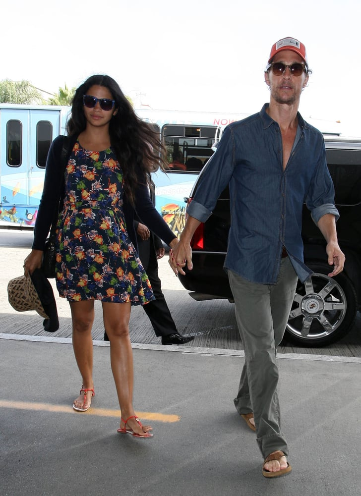 Matthew McConaughey lead Camila Alves into LAX.