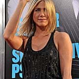 Jennifer Aniston waved to the cameras at the Horrible Bosses premiere.