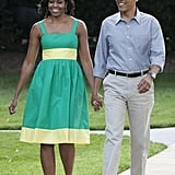 The Obamas walked during a congressional picnic at the White House.