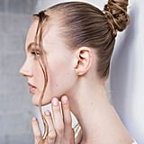 "As a rule of thumb, when hair is wet, it's easier to wrap it up into itself. For a visual, imagine all those times when you've wrapped your hair into a bun after getting out of the shower or a pool without using a hair tie (re: the ""twist and tuck"" method). You'll have a sleek updo, like this one from the Thakoon runway show, that's strong enough to hold itself up without having to search for a hair band."