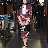 Katy Perry decided on an all Prada ensemble consisting of a purple, black and white dress that she accessorised with a floral clutch and platform sandals — all from Prada.