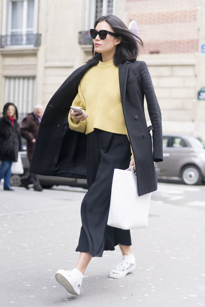 Break up a suit with a bright jumper.