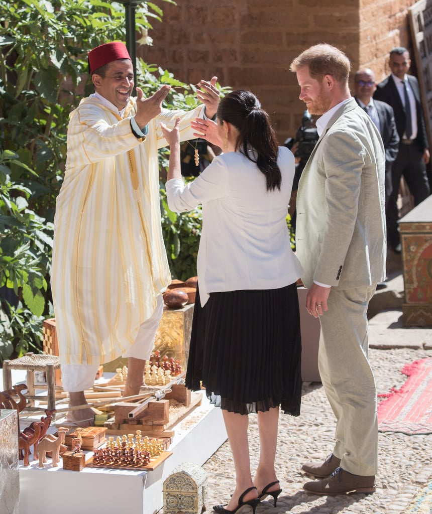 Prince Harry Helping Meghan Markle Fix Her Hair In Morocco