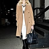 Ultrachic white pieces got a seasonal finish with a classic camel coat and Givenchy boots.