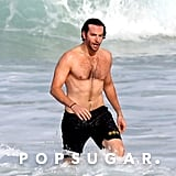 Bradley Cooper played around in the waves in Rio.