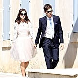 While her tulle dress and Chanel tweed jacket served as both a girlier and more informal choice as far as wedding looks go, she polished it all off with her signature bohemian flair. A floral wreath, sunglasses, pendant necklace, and ballet flats played into her low-key look perfectly. Source: Spread/X17Online.com