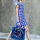 Some Models Carried Blue PVC Totes With Matching Handbags