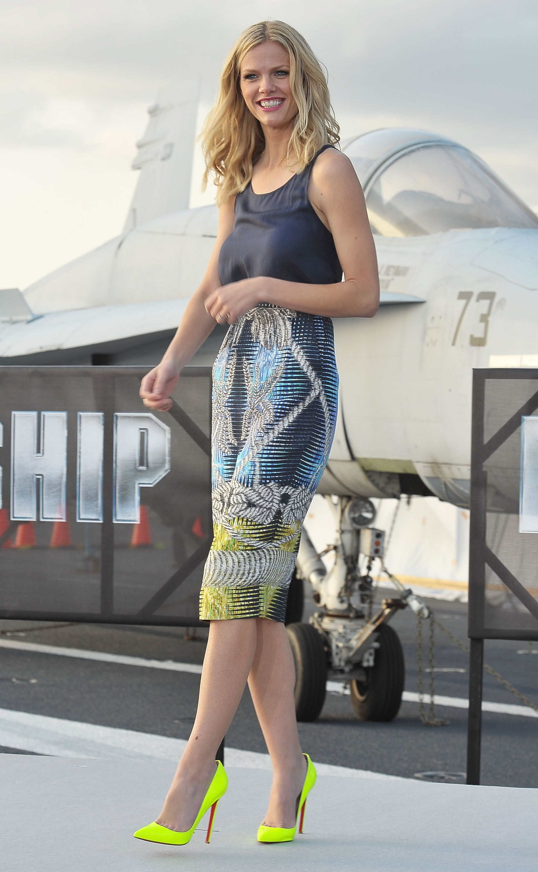 Brooklyn lit up the Japan photocall in a tropical Peter Pilotto print and a pair of neoprene Louboutins.