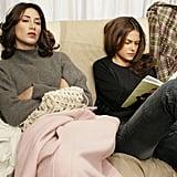 A model found a comfy spot to read ahead of the Dana Buchman Fall 2005 fashion show during Olympus Fashion Week.