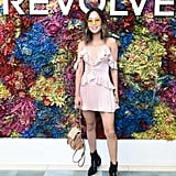 Aimee Song wearing a ruffled slip dress and Chloé bag at the Revolve festival.