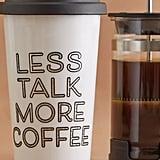 كوب مطبوع عليه عبارة: قلّلي من الكلام واحتسي المزيد من القهوة