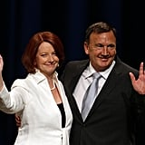 Julia Gillard and her partner Tim Mathieson wave to the crowd at the Labor Party election night function on Aug. 21, 2010.