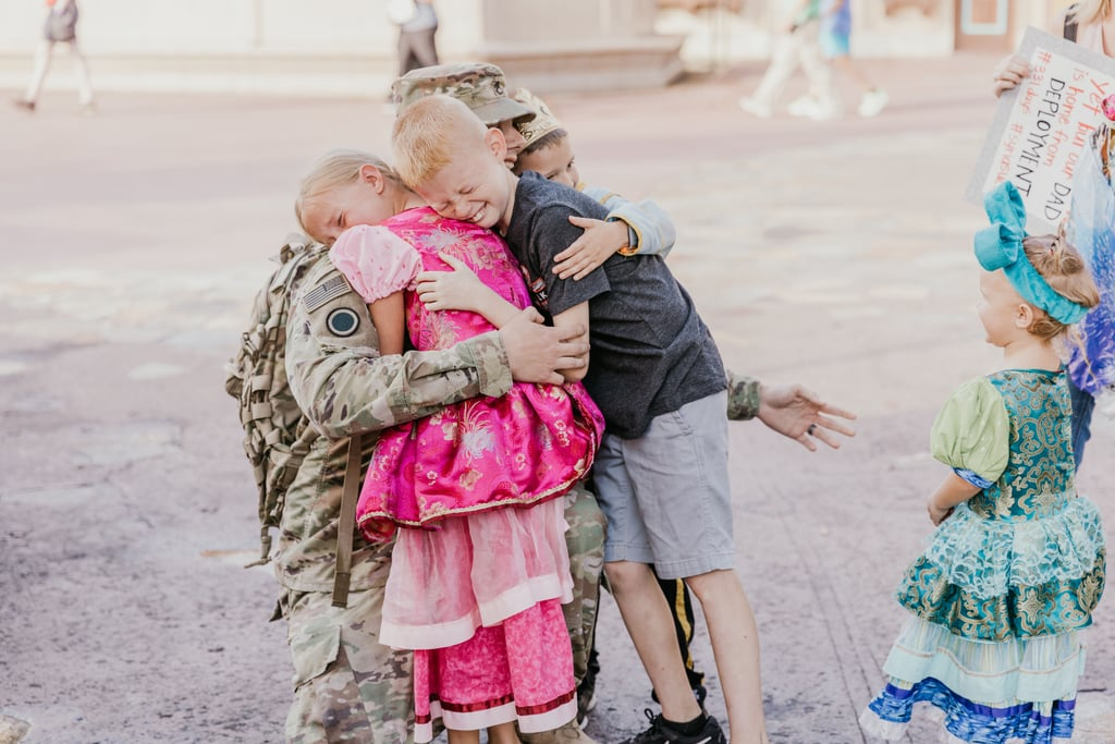 """US Army Staff Sergeant Byron Yates, a father of five from Pinellas County, FL, had not seen his children since he was deployed to Syria a year ago. With 13 years of military service and three deployments under his belt, Byron and his wife, Samantha, opted to give their little ones the ultimate surprise: a sweet family reunion at Disney World.  Under the impression that their father was coming home in March, the five Yates kiddos were absolutely shocked to see him in January. Samantha and Byron enlisted the help of Gainesville-based photographer Shannon Fries to capture the emotional moment, and the resulting shots are absolutely wholesome. """"It felt like hours waiting there and then I just felt him behind me."""" """"The homecoming was better than I could have ever imagined,"""" Samantha told POPSUGAR. """"We were able to get Cinderella's stepsisters, Anastasia and Drizella, in on the surprise. We usually visit Disney twice a week and seeing them is a must for the kids, so getting them to help was amazing. That way we didn't do anything out of the norm. Shannon took the most incredible pictures of our family that we will cherish for a lifetime! The kids were super surprised, they had no idea. I planned it with him so I knew, but it felt like hours waiting there and then I just felt him behind me, and the kids turned after Shannon told them someone else was in the picture."""" As you can imagine, it was an incredibly emotional moment for the five children. """"My oldest son started crying and went to hug his dad. Our oldest daughter turned around and instantly began crying and covering her face, she was so shocked that he was home. She didn't move towards him for what seemed like minutes until he put out his arms to hug her,"""" Samantha recalled. """"She continued to just hug him and cry.""""  While Samantha and Bryon's three younger kids reacted more mildly, the Yates family was delighted to be reunited again. """"After the initial surprise, we took pictures and the kids kept asking if this was """