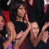 Michelle clapped from the audience.