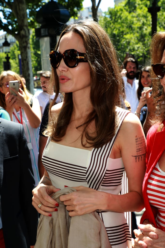 Angelina Jolie rarely changes up her brown hair, but the actress and philanthropist just made an unexpected switch for Summer. Jolie, who was previously spotted earlier this month with medium-brown hair and lighter highlights while in Colombia working with the United Nations High Commissioner for Refugees, just stepped out on the Champs Elysees in Paris, France with a deeper chestnut hue. Traditionally, most people (including many celebrities) tend to go lighter for the Summer months, but Jolie decided to do what she does best: completely stray from the norm and opted for a darker colour instead. Check out her new hair colour, ahead.