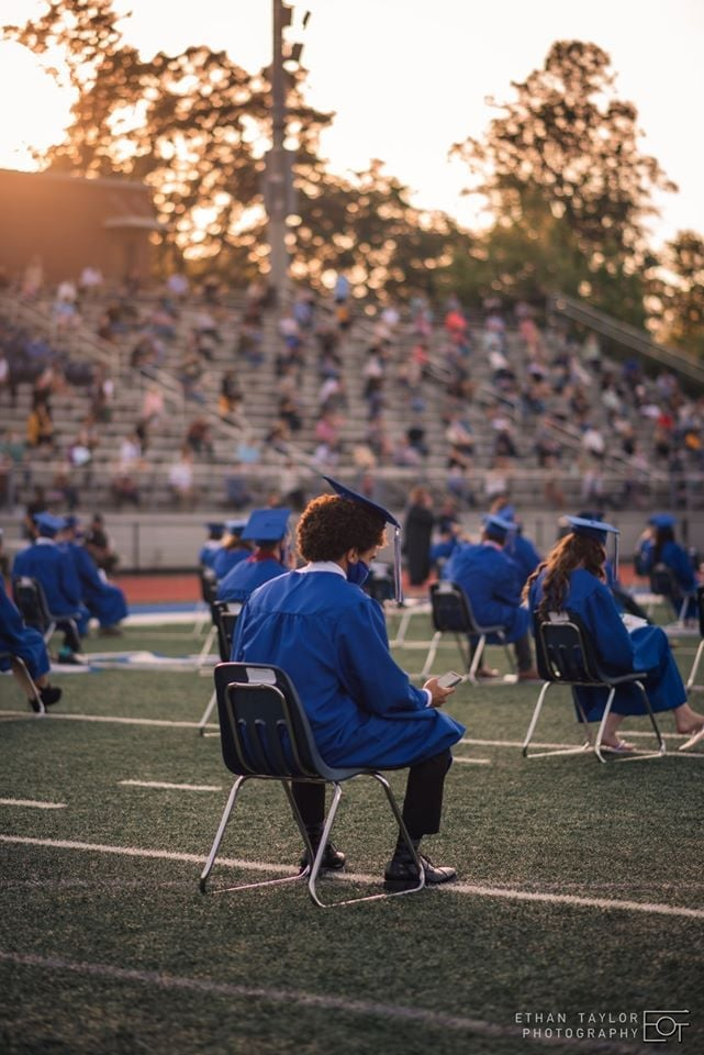 """In May, Ethan Taylor and his girlfriend Carly Hellerstedt had the chance to photograph a socially-distanced graduation ceremony at Fannin County High School in Georgia. Having graduated from the same high school just a few years prior, Ethan and Carly were determined to make the experience memorable for the students. """"The school hosted a group ceremony so that the students had a secondary, more traditional celebration,"""" Ethan told POPSUGAR. """"It was very emotional and surreal to be a part of. It felt like we were making history, Carly and I even took photos of ourselves with our cameras and in masks to remember it by. It wasn't sad, but it was definitely intense and emotional to be down there."""""""