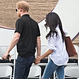 Meghan wore her sleeves rolled up and left the whole shirt untucked.