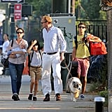Jennifer Connelly, Paul Bettany, Agnes Bettany, Stellan Bettany, and Kai Dugan walking their dog.