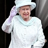Queen Elizabeth II waves to the crowds at her Diamond Jubilee in 2012.