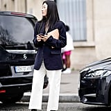 Don't overlook the basics: a navy blazer and black boots ground a cropped white pair.