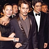 Kate Moss held onto Johnny Depp at the Cannes Film Festival in 1998.