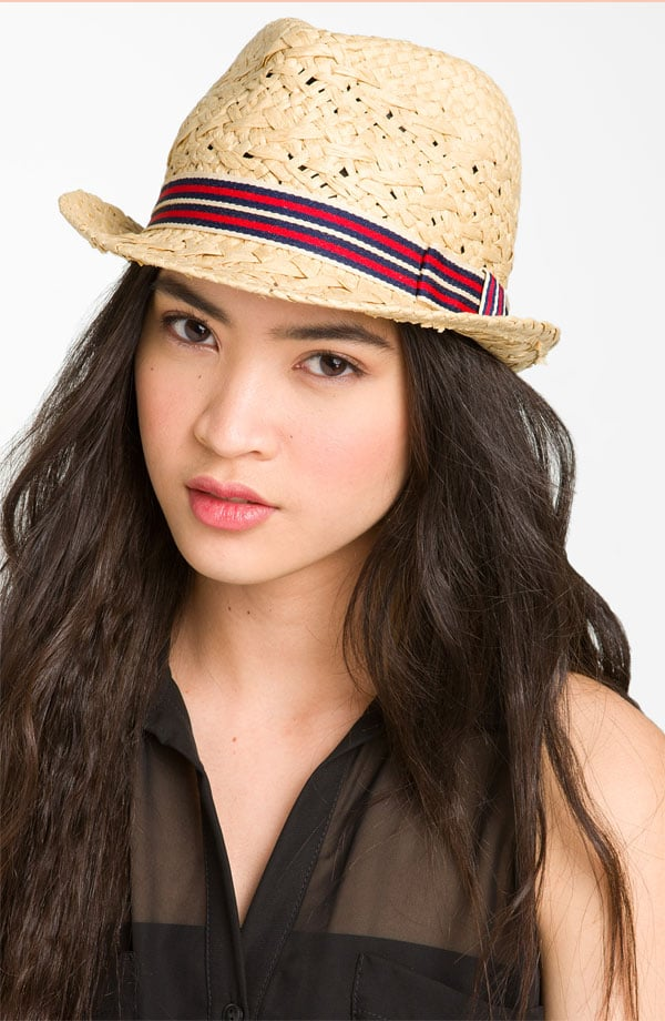 Ever since spotting Diane Kruger in an array of open-weave straw fedoras, we don't think a vacation would be complete without a similarly sleek sun hat. Plus, the striped band gives it flair.  Something Special Stripe Band Straw Fedora ($22)