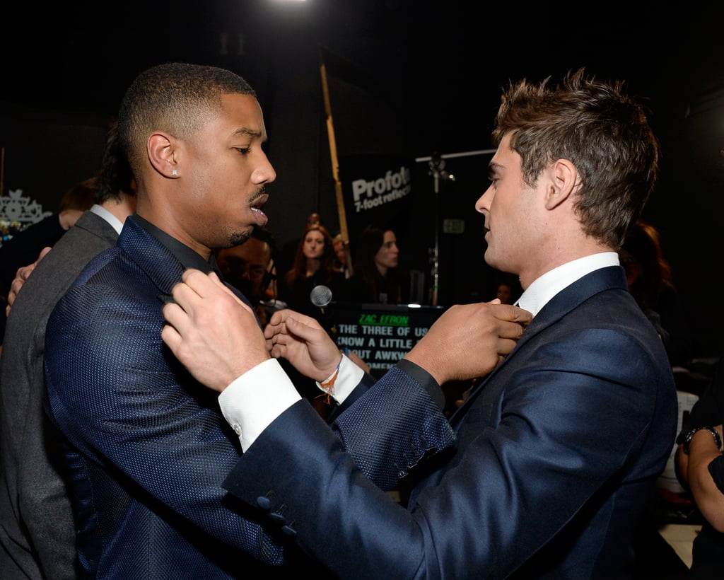 Zac Efron and his That Awkward Moment costar Michael B. Jordan straightened each other's ties before taking the stage with their costar Miles Teller.