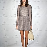 Alexa Chung looked party-perfect in a dress by Lover — the kind that's ideal for adding to your holiday-dress wardrobe.