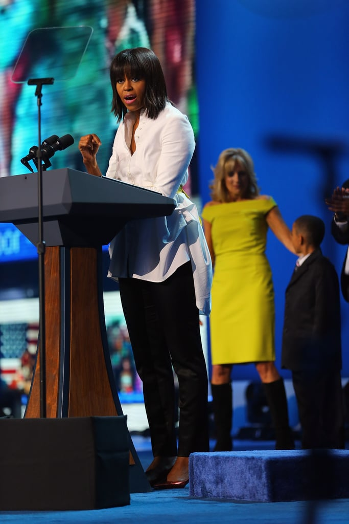 Michelle partnered a crisp white Alexander McQueen Spring '11 jacket (one she's been spotted in before) with black trousers and a yellow embellished waist belt at the Kids' Inaugural Concert.