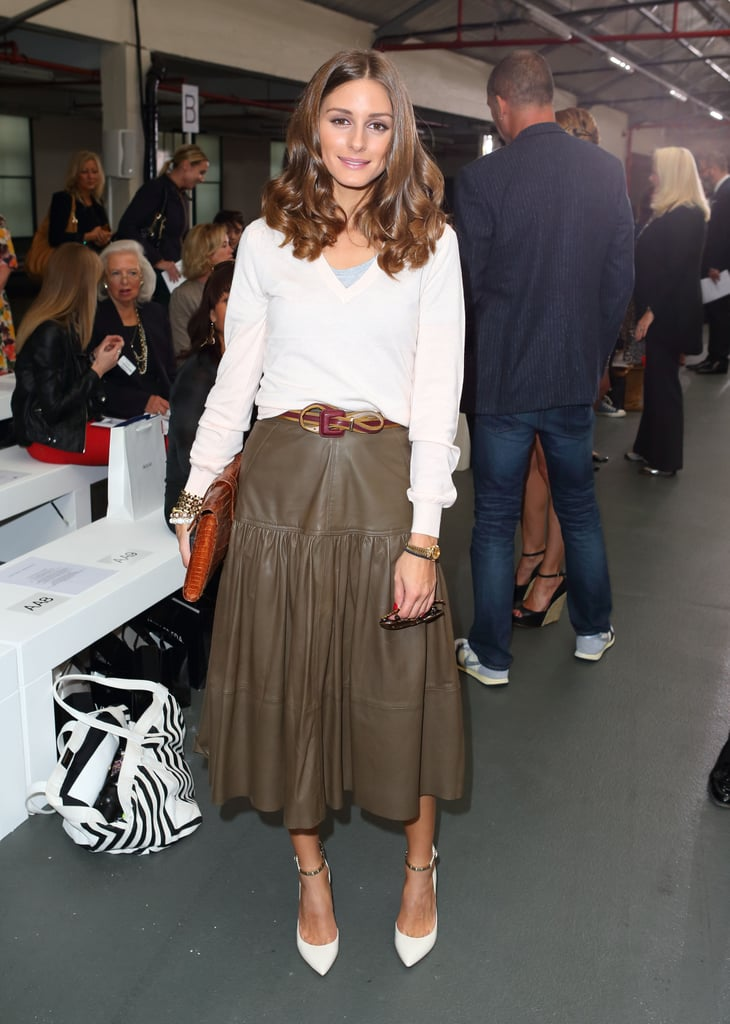 Olivia Palermo styled up a leather midi skirt and ankle-strap heels at Antonio Berardi.