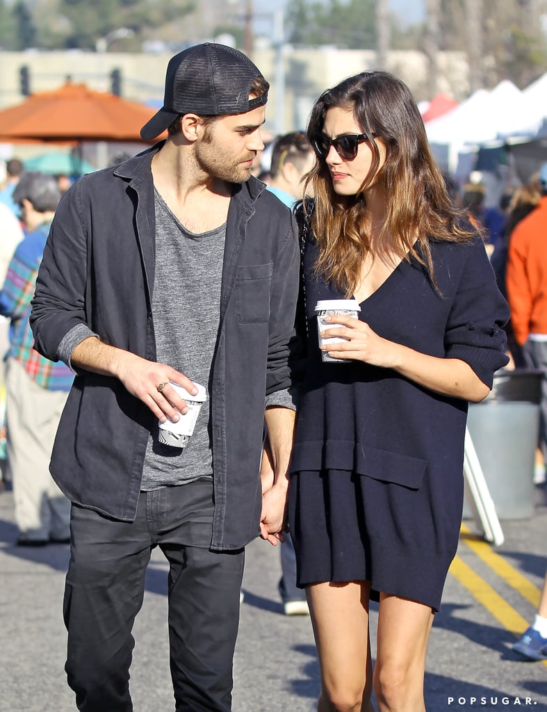 """Are Paul Wesley and Phoebe Tonkin giving their love another try? After calling off their four-year relationship in early March, the two were spotted holding hands in LA on Sunday. The former Vampire Diaries costars looked quite cozy as they strolled through the farmer's market together. While Phoebe donned a navy sweater dress, Paul kept things casual in a gray shirt, dark jeans, and a light jacket. While it isn't clear if they've resumed their relationship, an E! News source did add that they are """"still good friends"""" after their split. Perhaps it was just an outing between amicable exes that involved slight PDA?"""