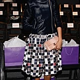 Selita Ebanks donned a ladylike checkered skirt with a velvet biker jacket and a Chanel purse at Noon by Noor.