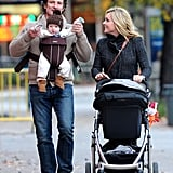 Robert Godley had some fun with a forward-facing baby Bennett while out for a stroll with mama Jane Krakowski.