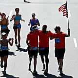 Men had their arms around one another as they completed the marathon.