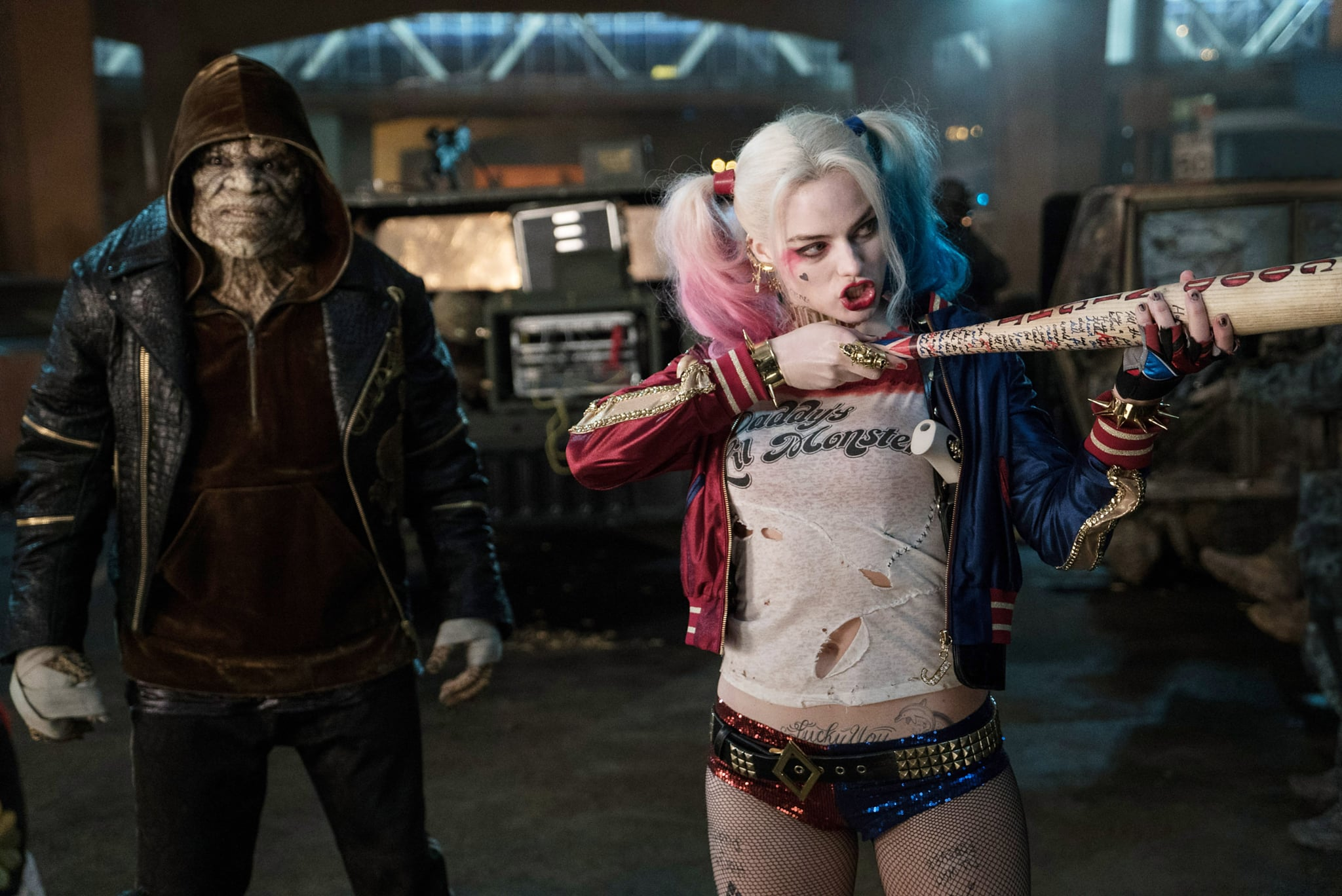 SUICIDE SQUAD, from left: Adewale Akinnuoye-Agbaje, Margot Robbie, 2016. ph: Clay Enos /  Warner Bros. / Courtesy Everett Collection
